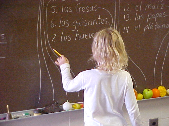 child at school blackboard